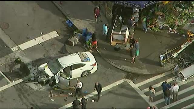 News video: Raw: Car Jumps Curb in NYC, Injures 8